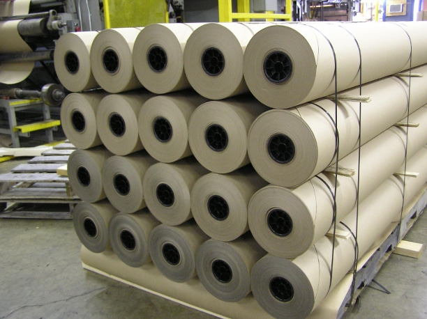 Rolls of kraft paper awaiting conversion for glass interleaving