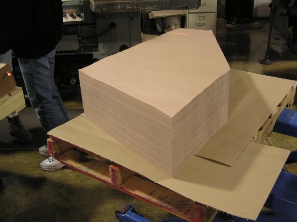 Kraft paper custom sheeted for glass interleaving application